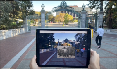 Photo of campus building with augmented reality images floating in front of it